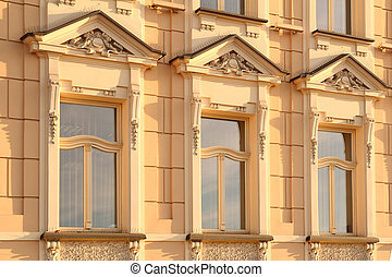 three windows with ornamental decorationon- Krakow, Poland