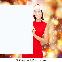 woman in santa helper hat with blank white board -...