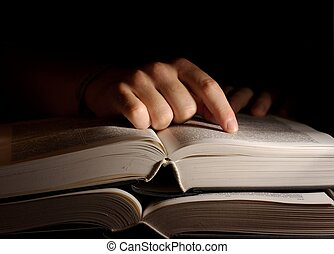 Open Book - Open book in the dark with a hand