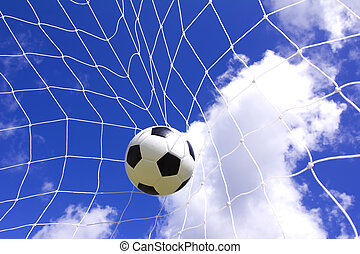 Soccer football in Goal net - Soccer ball in goal net over...