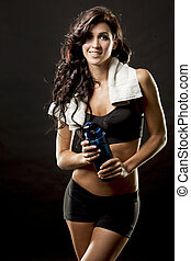 fitness woman - fitness model brunette wearing black on...
