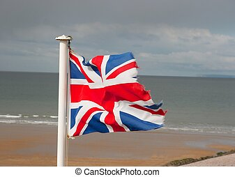 Flag of United Kingdom on the shore