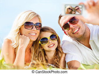 happy family with camera taking picture