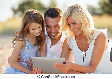 happy family with tablet pc taking picture - summer...