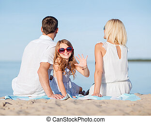 happy family on the beach - summer holidays, children and...