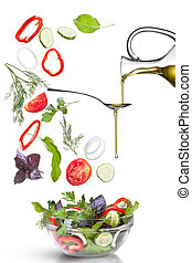 Falling vegetables for salad and oil isolated