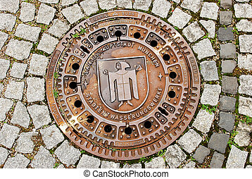 Man hole cover in Munchen , Germany