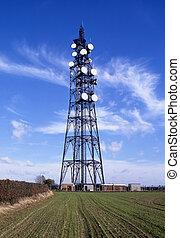 Communicating - Mast with white dishes used for transmitting