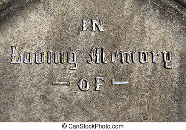 In Loving Memory inscribed on a gravestone.