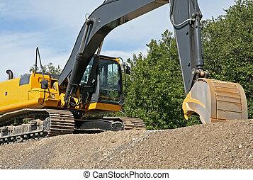 Excavator with bucket shovel - Yellow excavator on top of...