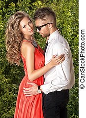 dating couple - Beautiful romantic couple in love standing...