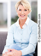 senior woman sitting at home - beautiful senior woman...