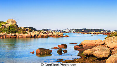 Ploumanach, rock and bay beach in morning. Toned. Pink granite coast, Perros Guirec, Brittany, France. Long exposure.