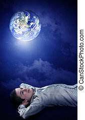 Planing his future on earth - Young man dreaming to his...