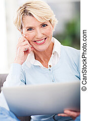 attractive middle aged woman with laptop computer