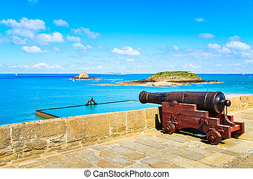 Old cannon along Saint Malo wall ramparts and fort Brittany,...