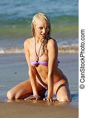 Sexy beach girl - Sexy woman wearing purple bikini posing on...