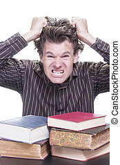 Freaking out - Young stressed male Caucasian student freaks...