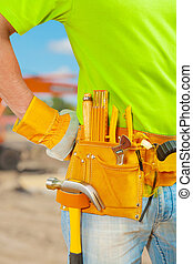 worker with tools in belt