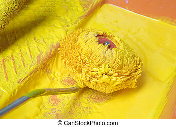 yellow paint - Dyeing roller in yellow paint