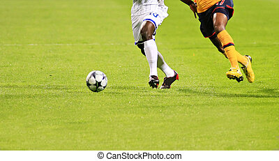 soccer - Detail of a soccer game with two players in action