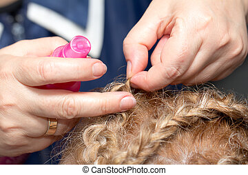 braided hairstyle of hair in a beauty salon