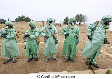 chemical protection suites - soldiers dress chemical...