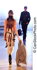 Defile - fashion model from behind