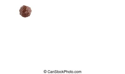 Chocolate bonbon isolated on a white background, slide from...