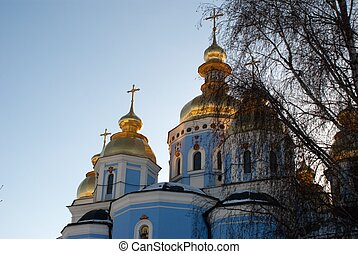 Church - Gold domes of the Mikhaylovskogo with the roof of...