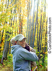 Father and Son Hugging in Autumn Forest - A happy thirty...