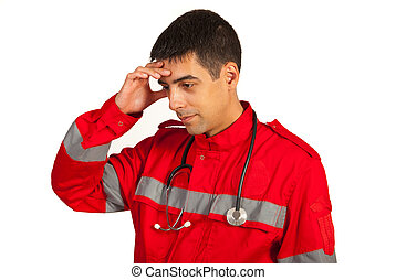 Pensive paramedic man holding hand to head isolated on white...