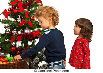 Amazed girl and boy with Christmas tree