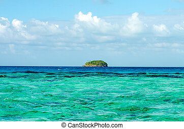 Island on the Horizon - Small green island on the horizon of...