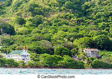 Island Landscape - View of a church and other building off...