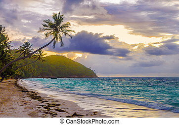 Caribbean Sunrise - Purple and orange sky of sunrise on a...