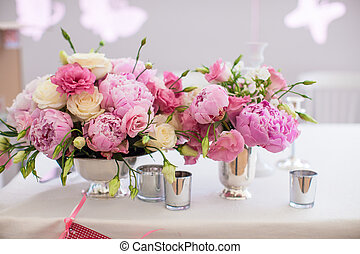 Beautiful bright bouquet of peony on the wedding table in...