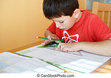 boy doing school homework from geometry mathematics in...
