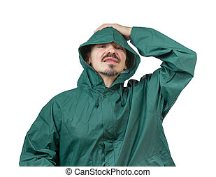 Do not forget your rain gear. - Caucasian man in hooded rain...