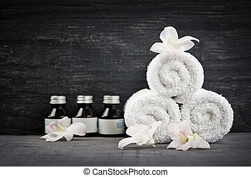 Rolled up towels and products at spa - White rolled up...