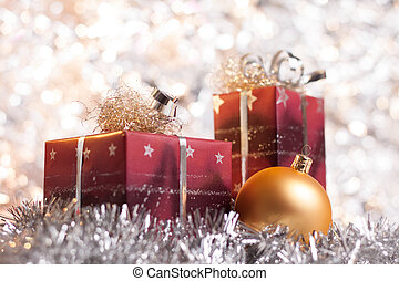 Christmas ball and gifts on abstract light background