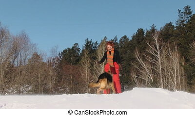 Beauty woman with dog in winter cou