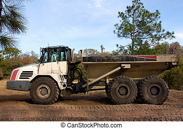 heavy duty dump truck - profile of a large white and black...