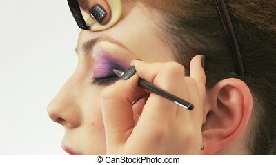 Woman having make up in beauty salo