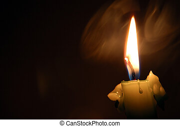 dark candle - smoke and candle flame burning in the darkness