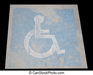 Handicap - Worn Handicap sign on pavement