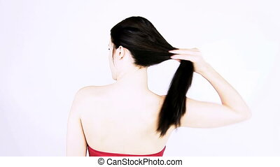 Woman undoing ponytail slowmotion - Beautiful woman undoing...