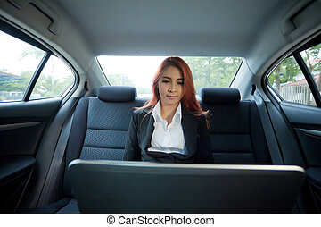 Woman using laptop - Beautiful young business asian woman...