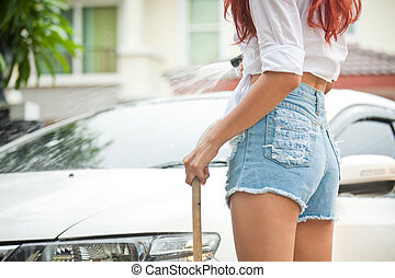 Woman washing a car - Sexy asian woman washing a car at home