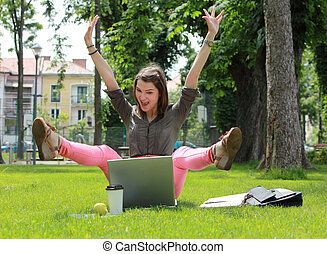 Happy Woman with Computer in an Urban Park - Excited happy...